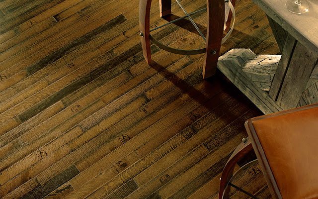 Narrow plank hardwood adds a rustic touch to this floor.