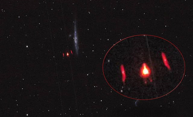 Red star like UFO seen through telescope Mufon case number 91964.