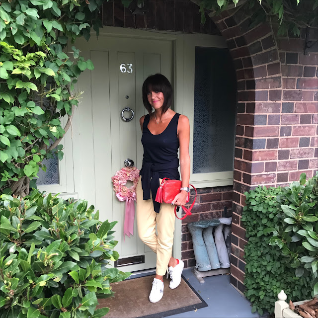 my midlife fashion, marks and spencer leather trousers, golden goose superstar low top leather trainers, j crew tank top tee, marks and spencer cashmere crew neck jumper, uterque leather tassel leather cross body bag