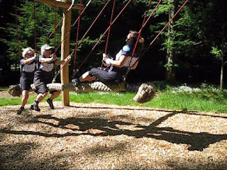 Three women on the group swing, Drumlanrig Castle, Scotland