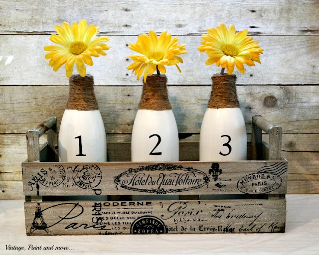 French graphics wooden box with painted, stenciled and twine wrapped milk jars and yellow daisies