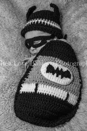 Newborn baby Jacob dressed as Batman