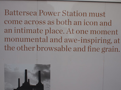 Developers' hoardings in front of BAttersea Power Station, London: pious sloganeering