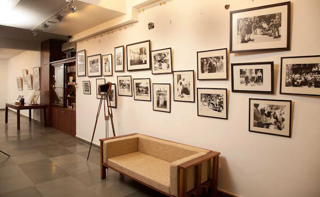 Last weekend I visited  INDIA PHOTO ARCHIVE FOUNDATION and it was a wonderful opportunity to know more about old technologies around Photography and the way one of the great Indian Photographers works. It was a very interactive meet with Aditya Arya, who is one of the famous Indian Photographers and popularly known for his work in 'India Photo Archive Foundation' Before I start sharing about the experience, just check out the video below -(All photographs used in this Photo Journey are picked form different websites or Aditya's Facebook Profile. So none of these are clicked by me)After reaching Aditya's place, we spent some time around his Camera Collection and the place where he has kept archives. INDIA PHOTO ARCHIVE FOUNDATION IS REGISTERED AS PUBLIC CHARITABLE TRUST, a Trust for Creation of awareness of contemporary and historical photographs, creation of archives, and highlighting the historical value of photographic archives and collections and to encourage the dissemination, access and use of such archives for academic, institutional and cultural purposes.Aditya has worked on various books and I also looked at two of his books. One was on Nagaland, where he visited many times to understand the place and people. One of his book 'HISTORY IN THE MAKING' was launched at NCPA, in presence of Bollywood Actor Anupam KherAditya Arya planned some of the exhibitions to showcase photographs clicked by the legendary photographer Kulwant Roy. Roy's collection of candid moments of Pandit Jawaharlal Nehru, Mahatma Gandhi, and other stalwarts of early 20th century India, are very well preserved by Mr Arya. Roy's collection was inherited by his nephew Aditya Arya, who himself is a professional photographerMore work by Aditya Arya can be checked at - http://www.adityaarya.com/ and to know more about him, check out http://www.adityaarya.com/#/about/bio-info-pagThe Aditya Arya Archive (http://www.adityaaryaarchive.com/) is based on the almost forgotten photographs of the important early Independence movement photographer Kulwant Roy (1914-1984). Founded by his nephew, a professional photographer, the archive is actively pursuing the restoration of other collections on the verge of being lost to history. Twenty five years after the passing of his uncle, Kulwant Roy, when photographer Aditya Arya opened the boxes that had been bequeathed to him, he was astounded. He was looking at a treasurehouse of images of pre- and post-independent India. Photographs systematically organised and annotated, negatives carefully packed together, notes painstaking scribbled at the back of fading photographs.A lifetime of work of photojournalist, Kulwant Roy. And so it was that Aditya Arya's journey of archiving began. Drawing from a collection of thousands of old prints and cracked negatives, the initial recovery has led to an exhibition of selected works in Delhi, the generation of worldwide interest in Roy's work, and the establishment of the Aditya Arya Archive.The team at the Archive is led by Aditya Arya, and draws upon the expertise of established archivists, historians, researchers, restorers, designers, writers and filmmakers.Words can never define the amount of efforts, which has gone on this whole project. I was fortunate to visit the place and spend some time with Aditya Arya to know about all this. Aditya has also a huge collection of old cameras of different types. He showed some of the FIRST cameras with some of the specific technologies. E.g.- He showed me first camera with concept of APERTURE. It was huge camera which used to come with rings of different sizes. So whatever aperture is required, photographer needed to change the ring before each shot. Similarly I saw FIRST camera with SHUTTER, which had shutter of think cloth. It was amazing to see wooden 3D viewers. I couldn't click photographs of these wonderful collection-pieces. It was hard to imagine the quality of 3D photographs in 1910 and innovative ways of viewing 3D photographs.After some Tea in the middle of this marvelous collection, we moved towards Digital workspace of Mr. Aditya Arya. Digital Space was even more impressive for me. iMACs with various Hard-Drives and Drobo Boxes for handling hundreds of terabytes. Mr. Arya plays with Lacs of photographs at any point of time. His digital workflows were really exceptional and he is very well equipped to handle this efficiently. Everything very well planned and organized. During this meet, we discussed about various things around Analog & Digital photography. He shared various things about his career and his style of working. Aditya is very detail oriented Photographer who believe in perfectness with his camera & negligible post-processing. During some chit-chat about Lightroom, I got a chance to look into his Raw photographs shot with Mamiya Leaf and all of them were perfect and no retouching was required. Aditya is really very well organized Photographer, who is very well aware of his digital workflows and can independently take care of it. During the conversation he showed me his store which was adjacent to his studio and it was full of equipments which we usually need for electrical, house-keeping or construction work. he is kind of person, who believes in doing things himself and be independent most of the times. I was amazed to notice few things like stone-cutter, weighing machine etc, apart from regular stuff as electrician or plumber uses. All this shows the independt nature of doing his work more efficiently.After all this great chit-chat at Aditya place, we went for dinner at DLF City Club and got some good suggestions from Aditya to be more focussed about Photography. Hope to catch with him again in near future, as such passionate people are good inspirations in life !