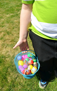 holding an easter basket filled with plastic eggs