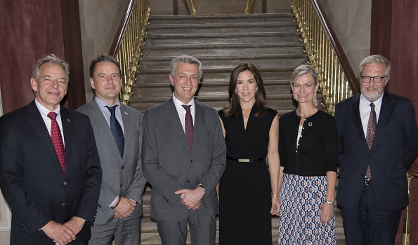 Crown Princess Mary attended a meeting with UN Refugee Chief Filippo Grandi at Amalienborg Frederik VIII's Palace. she wore black dress by Prada