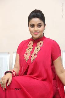 Actress Poorna Latest Stills in Red Dress at Rakshasi First Look Launch  0286.JPG