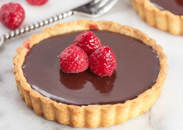 http://www.cookingonthefrontburners.com/2014/01/raspberry-truffle-tart.html