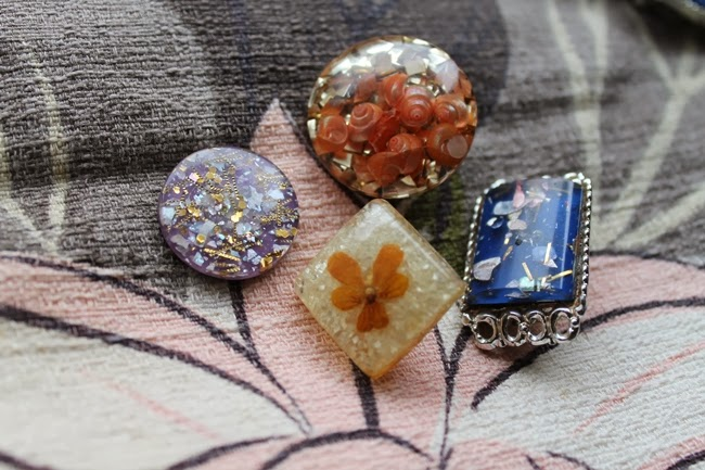 confetti lucite collection with glitter, flowers embedded and seashells
