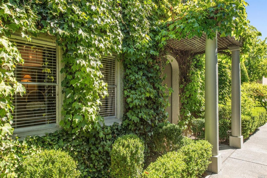 Ivy covered California home of Myra Hoefer with lush gardens and French inspired interiors. #ivyclad #ivycottage #MyraHoefer