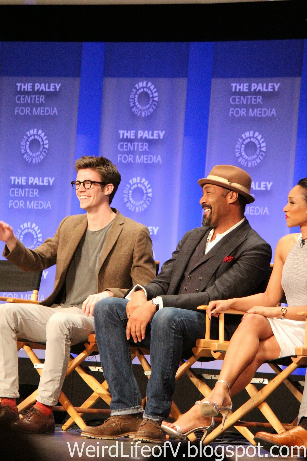 Grant Gustin and Jesse L. Martin laughing