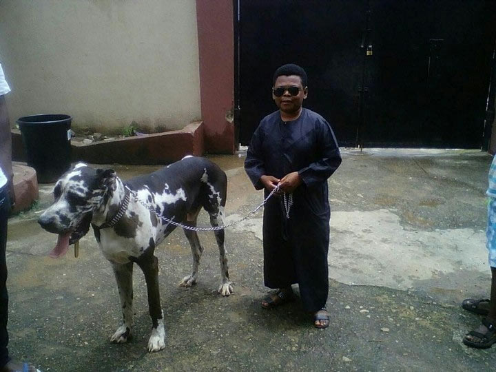 Actor Osita Iheme poses with his cute dog, Charlie
