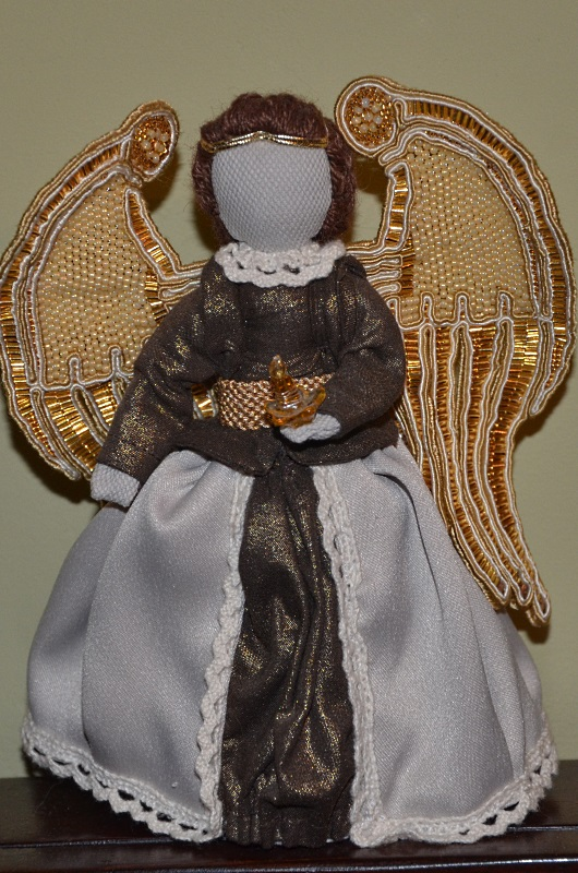 Golden Angel with beaded wings.