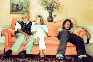 picture of adult child at home with his aging parents