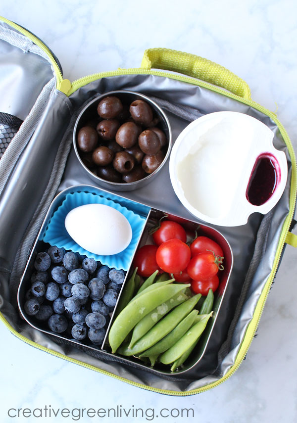 Make an easy gluten free bento box with peapods, tomaotes, blueberries, hardboiled egg and yogurt cup