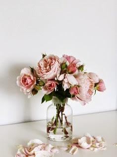 lovely light pink roses in a bottle