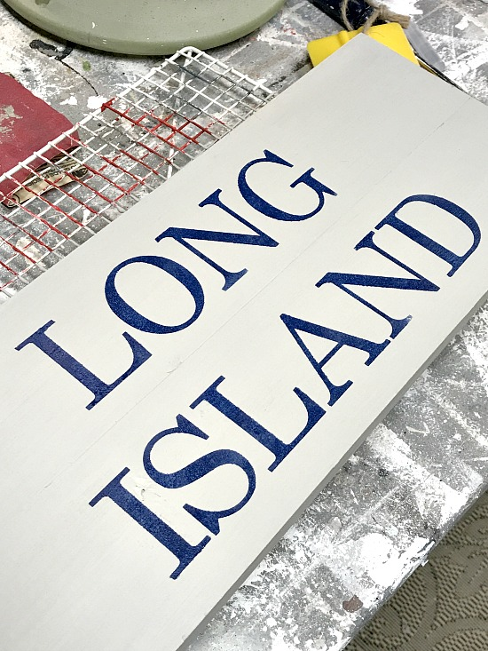 Long Island lettering on a wooden sign