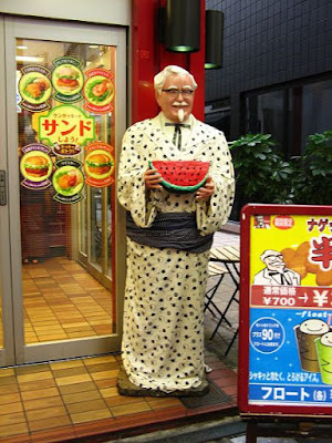 colonel sanders carrying watermelon