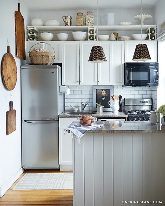 5 Clever Ways to Decorate the Awkward Space above Your Kitchen ... on decorating top of kitchen cabinets, glazed kitchen cabinets, small kitchen ideas with oak cabinets, decorate above shelves, ways to decorate kitchen cabinets, decorate above kitchen counters, decorate above fireplaces, decorate above bookshelves, decorating with plates above cabinets, decorate above kitchen sink, decorate above doors,
