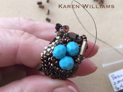 Just starting to work on the 'nest'.  Freeform peyote ring by Karen Williams