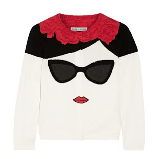 Alice and Olivia white cardigan with a red collar detail and a picture of black sunglasses and red lips
