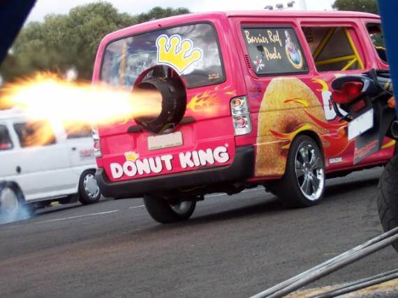 Donut King deliver van shoots down the road at high speed due to flaming jet exhaust out of back