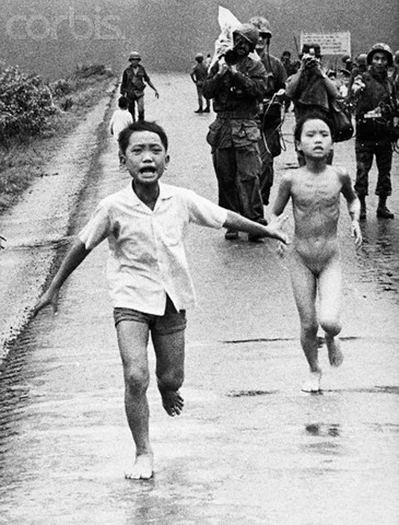 'Napalm girl' Phan Thị Kim Phúc, with her brothers / cousins, and South Vietnamese forces, fleeing from the flaming napalm pn 08 June 1972 in an attempt to escape an accidental napalm attack on Trang Bang, 26 miles southwest of Saigon, by South Vietnamese government aircraft.