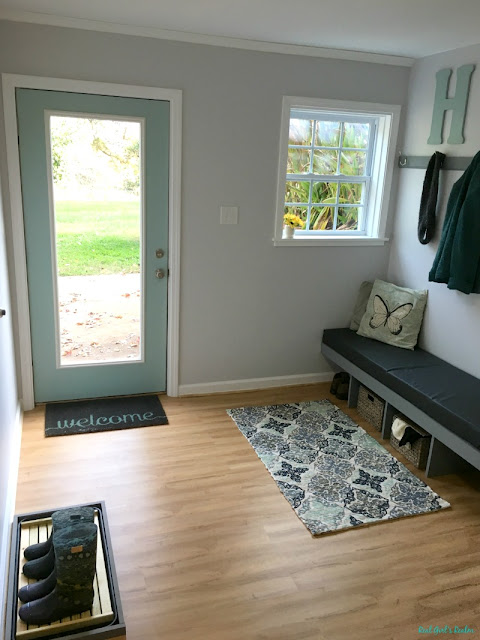 See how I transformed a dark basement entry way into a beautiful bright mudroom in just a few weeks.