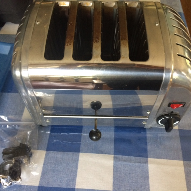Mending things replacing the timer in a dualit toaster to gain access to the timer you need to remove the crumb tray and flip the toaster on its top i use a plastic tray to sit the toaster in collecting any swarovskicordoba Choice Image