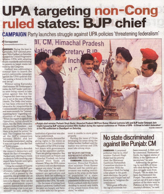 "Punjab Chief Minister Parkash Singh Badal, Himachal Pradesh Cm Prem Kumar Dhumal (extreme left) and BJP leader Satyapal Jain (Right) honoring BJP national president Nitin Gadkari during the regional conference on ""Policies of UPA –A threat to India's federalism' at the PGI auditorium in Chandigarh on Saturday."