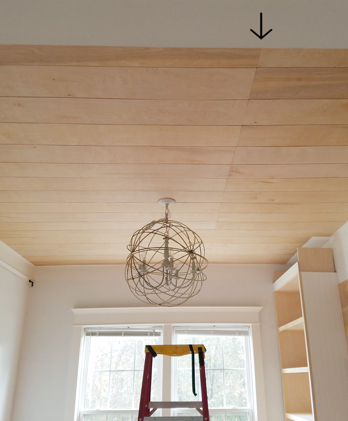 rustic plywood ceiling installation in dining room with big orbital chandelier