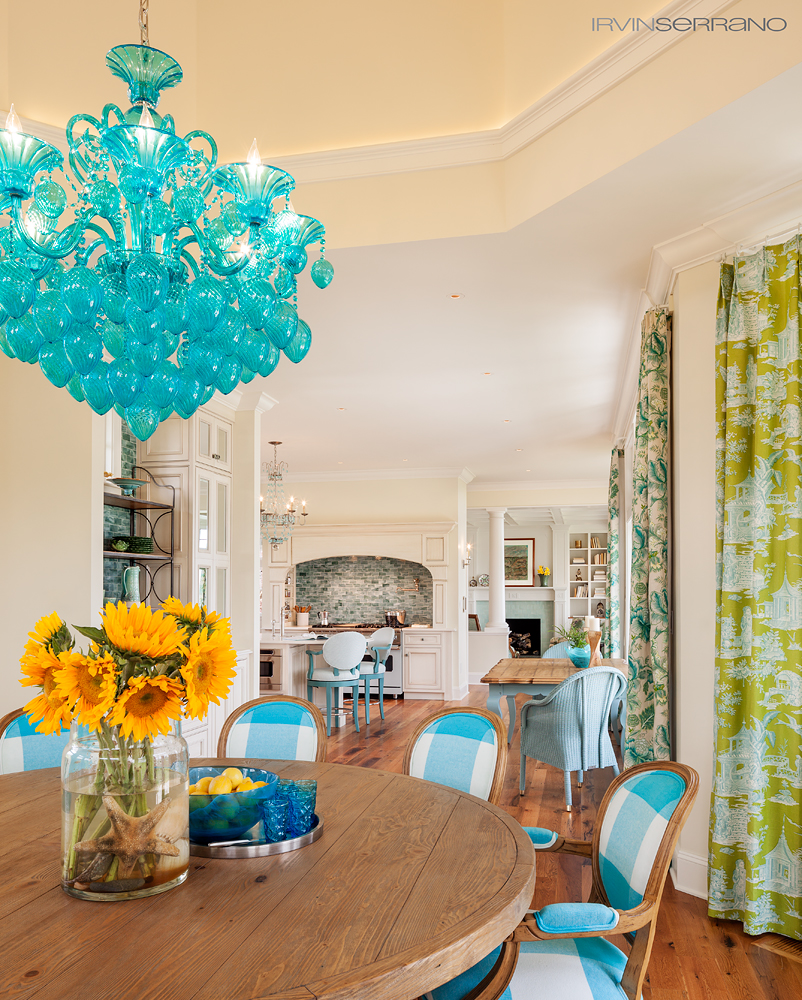 Teal accents fill the dining room and kitchen at an oceanview home built by Bowley Builders.