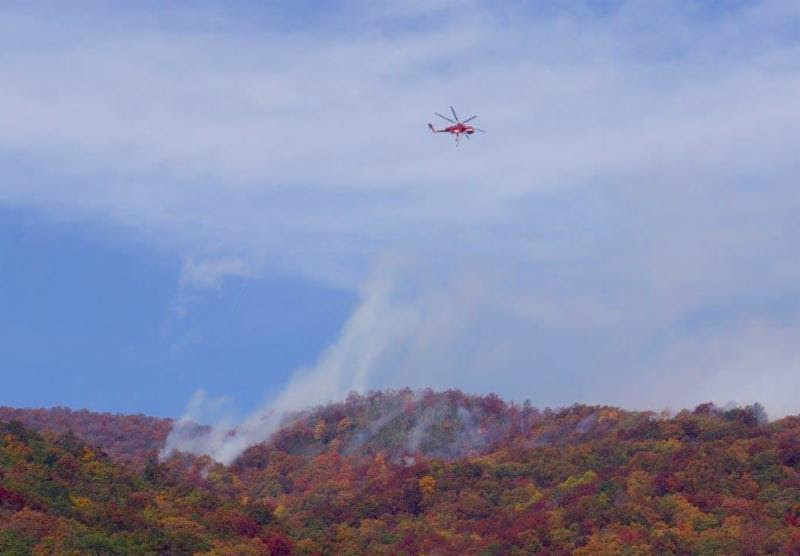 A Sikorsky Skycrane dumping water on the Boteler Peak Fire  Photo courtesy of the USFS