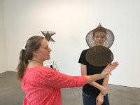Photo taken by Kurt Keller of Traci Van Wagoner and Jack McDowall at David Zwirner Gallery with Ruth Asawa sculpture