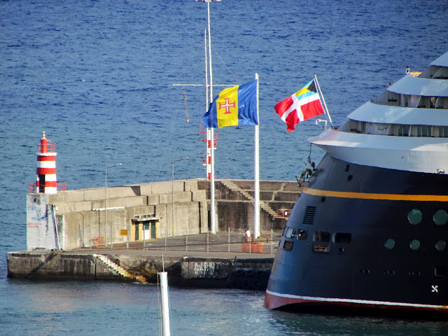 Madeira flag (left) and Disney Magic cruise ship flag in Funchal port