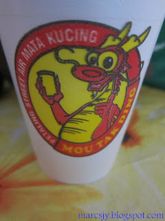 "This is the front cover of ""Petaling Street Mata Kucing"" that show the emblem."