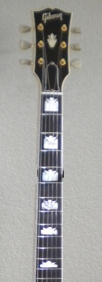 the headstock was topped with a traditional gibson flower-pot inlay and the  gibson logo  kluson tuners with white caps held the strings in place