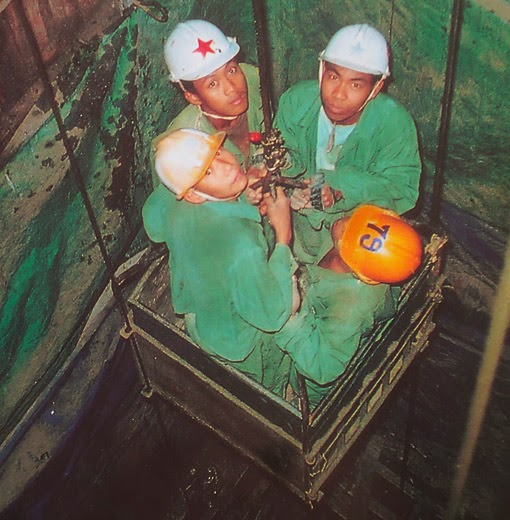 jadeite miners on the way to work deep in the earth