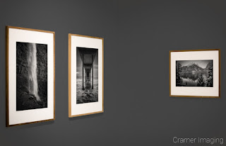 Cramer Imaging's photograph of three framed monochrome fine art landscape photographs on a grey gallery wall