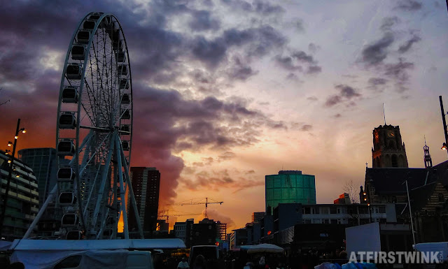 Rotterdam Blaak laurenskerk ferris wheel next to Markthal sunset clouds
