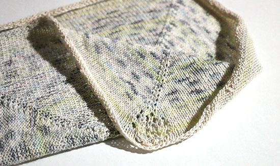Partially Folded Hand Knit Cotton Basket Liner with Lace Leaf Detail in Corners