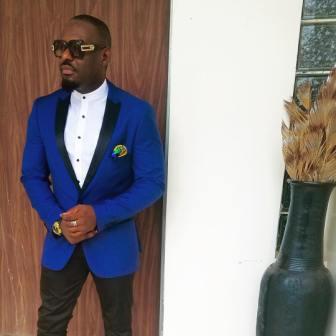 jim iyke in a blue suit