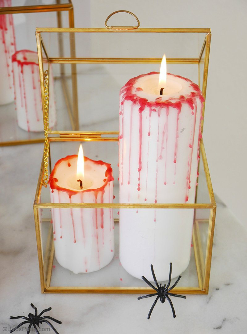 DIY Halloween Bloody Candles - great last-minute, quick and easy craft to help decorate any spooky table or room for a macabre, vampire vibe! by BirdsParty.com @birdsparty
