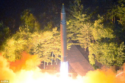 North and South Korea launch missiles as Pyongyang fires 'ICBM' over Japan and into the Pacific and Seoul retaliates with its own test