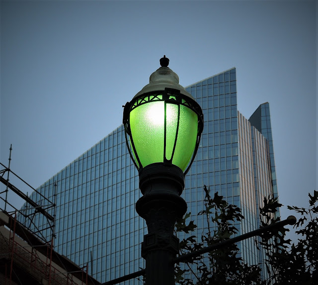 Street light with double-edged top of new Hines Office Tower on Main at Texas