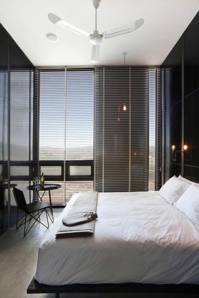 04-Bedroom-with-Views-Gracia-Studio-Cabin-Architecture-set-on-a-Hill-www-designstack-co