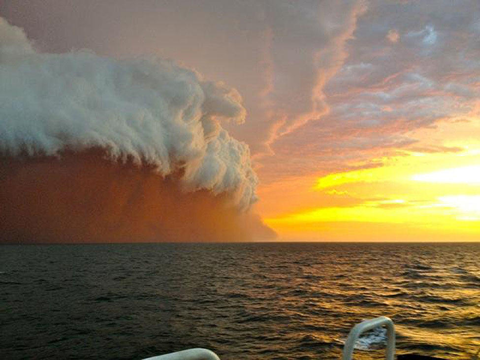 dust clouds formation over ocean, Australia