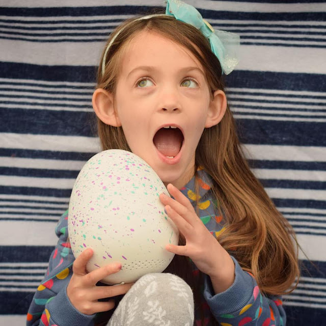 delighted child with Hatchibabies egg Hatchimals