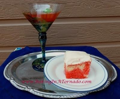 Cosmo Poke Cake | www.BakingInATornado.com
