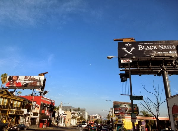 Black Sails cannonball hole billboard installation